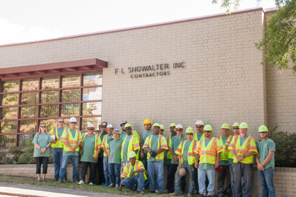 F.L. Showalter team standing outside headquarters