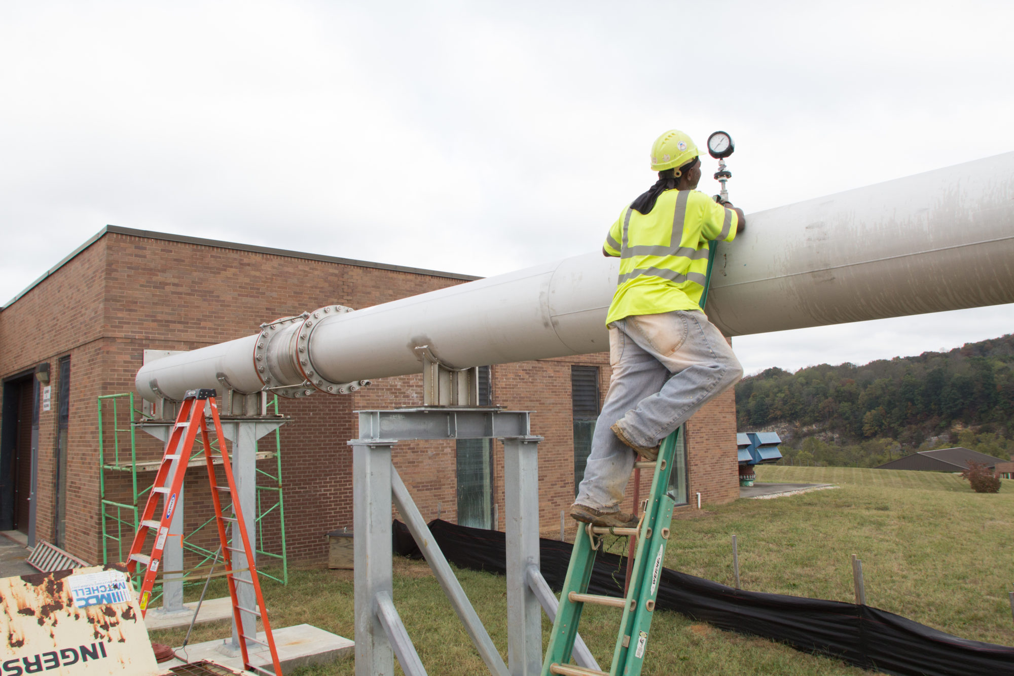 F.L. Showalter employee working on a pipe